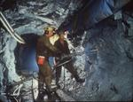 Driller and assistant, with jackleg drill, commence crosscut at small gold mine