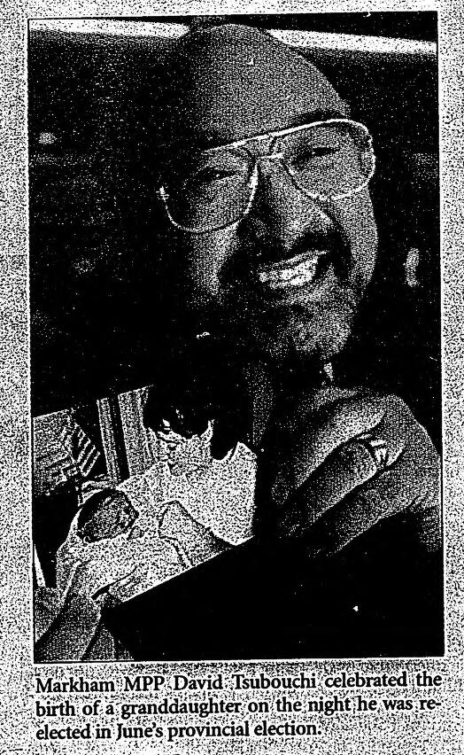 David Tsubouchi holding up a photo of his grandchild in the Stouffville Tribune, January 2000. Courtesy the Whitchurch-Stouffville Public Library.
